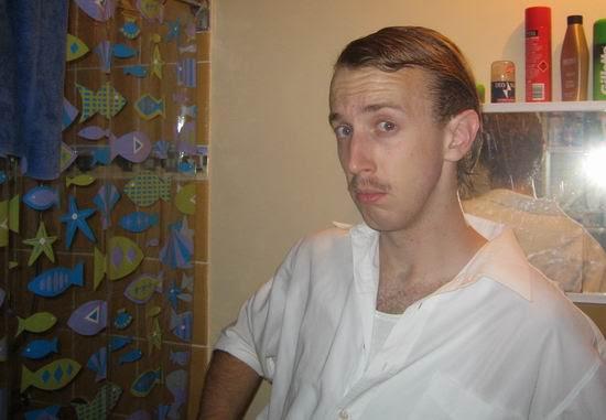 Slicked hair and mo.jpg