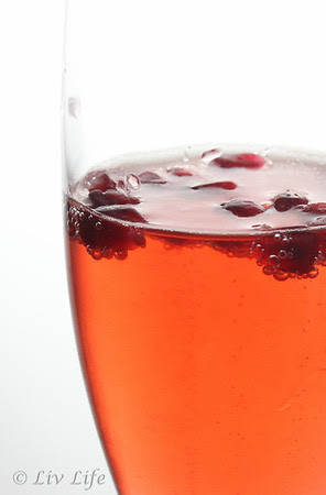 Champagne Pomegranate Cocktail with pomegranate seeds
