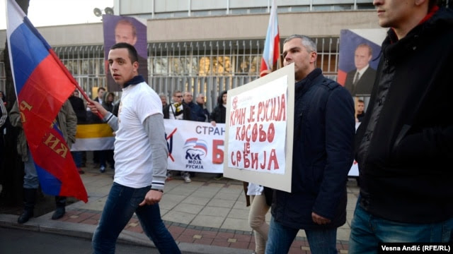 "In Belgrade, protesters backed Russia's military intervention in Ukraine: ""Crimea is Russia, Kosovo is Serbia."""