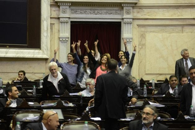A group of women legislators in Argentina's lower house, who in the early hours of the morning led a surprise vote that resulted in the approval of the law on gender parity in Argentina's political representation, celebrate their achievement at the end of the historic session. Credit: Chamber of Deputies of Argentina