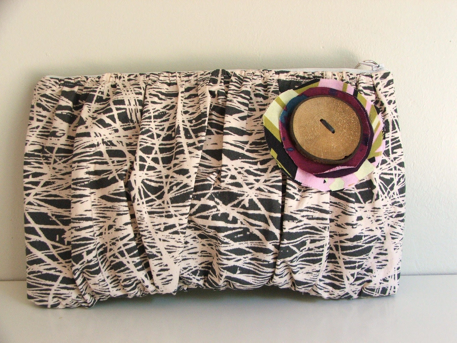 Gathered clutch with handmade button