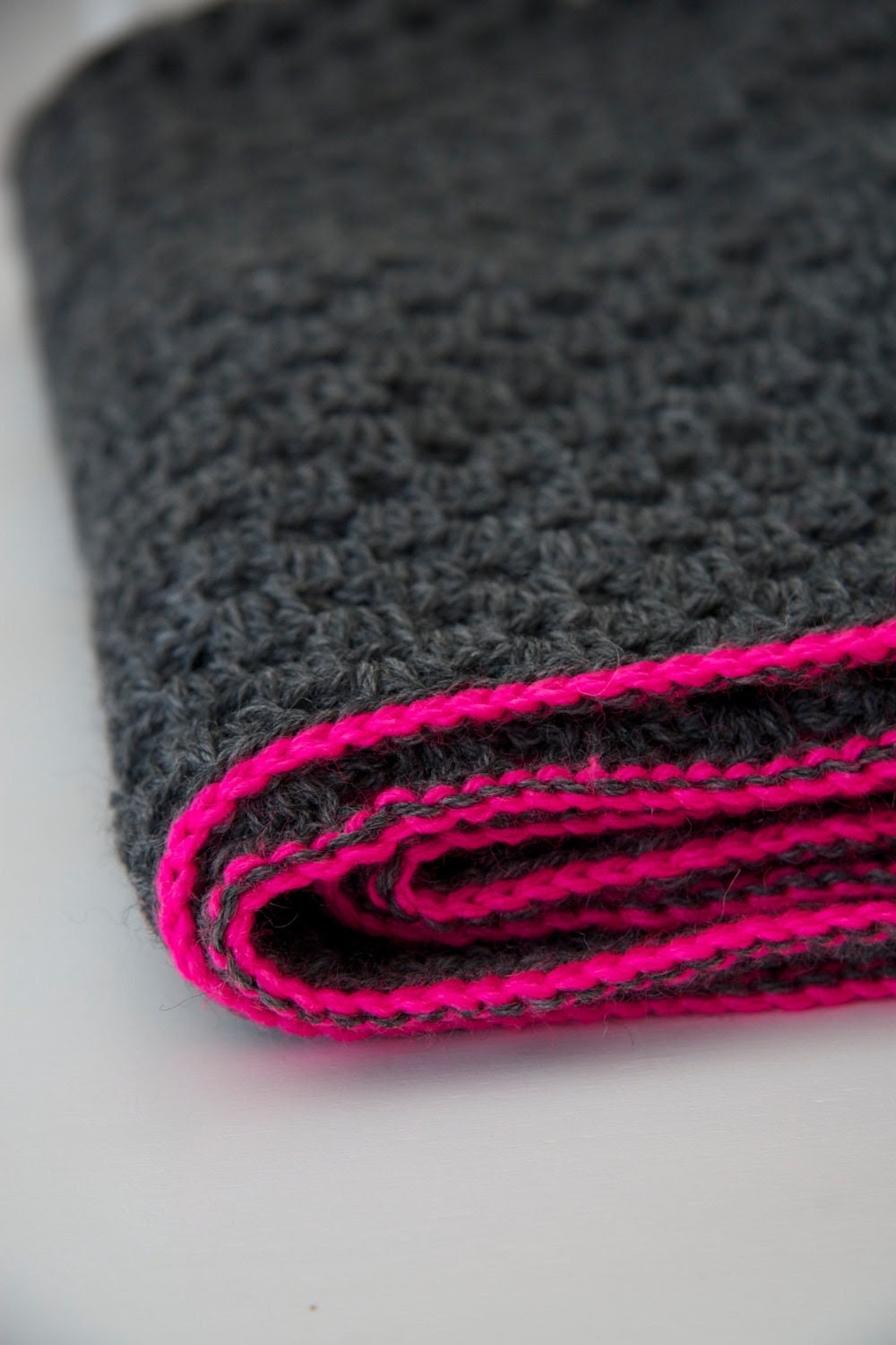 Granny square blanket with neon pink