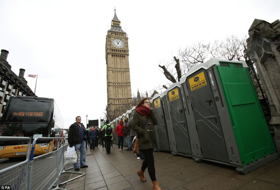 Dozens of Portaloos are moved into position close to Parliament as hundreds of thousands of people are expected to flock to London today