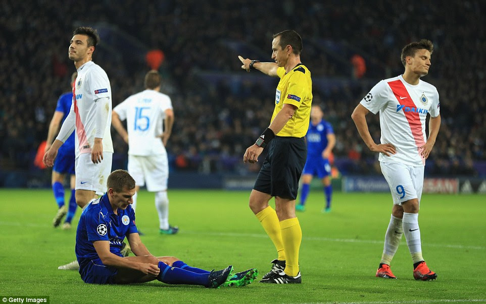 Referee Ruddy Buquet points to the spot as Cools (left) and striker Jelle Vossen (right) are resigned to the decision
