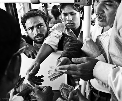 Bus conductor and commuters