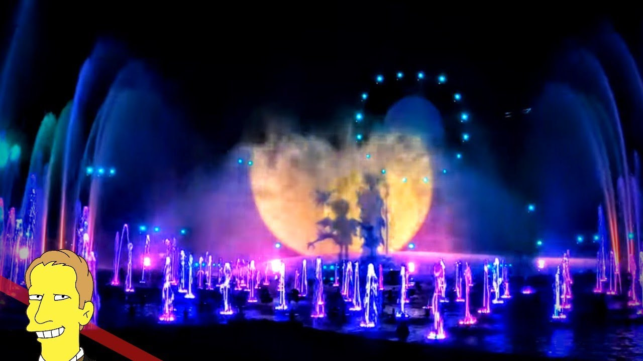 Colorful projection of World of Color onto water screen at Disneys California Adventure