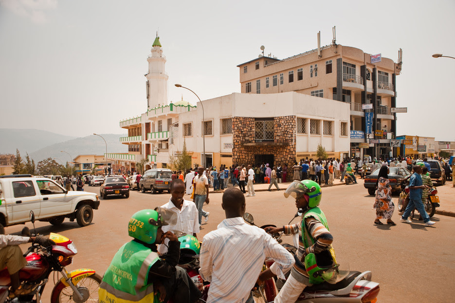 People crowd around the mosque and Forex Bureau currency exchange in downtown Kigali Rwanda