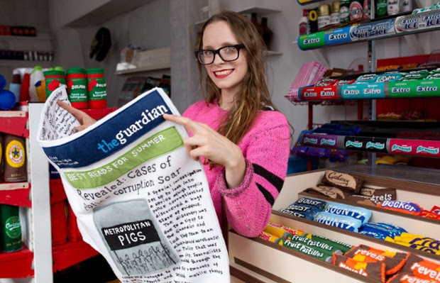 Artist Lucy Sparrow reads a felt edition of the Guardian.