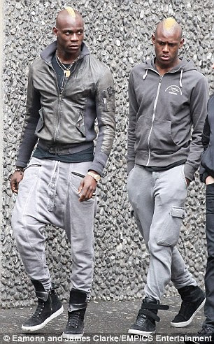 In trouble: Mario Balotelli's (left) brother Enoch Barwuah (right) was arrested in Italy for assaulting two police officers
