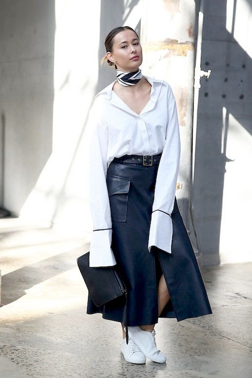 Le Fashion Blog Editor Street Style Eleanor Pendleton Oversized Silhouette White Shirt With Extra Long Sleeves And French Cuffs Neck Scarf Leather Midi Skirt Sneakers Via Popsugar