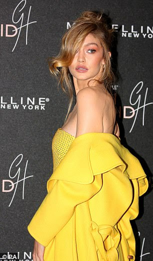 Working her angles: Gigi flashed a number of sultry poses as she worked the red carpet