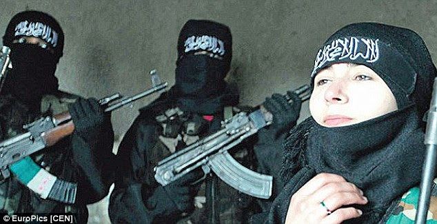 A picture believed to show Sabina Selimovic, 15, with jihadi fighters in Syria: An interview given by the Austrian teenager saying how she feels 'she can really be free' among the extremists may have been given at gunpoint