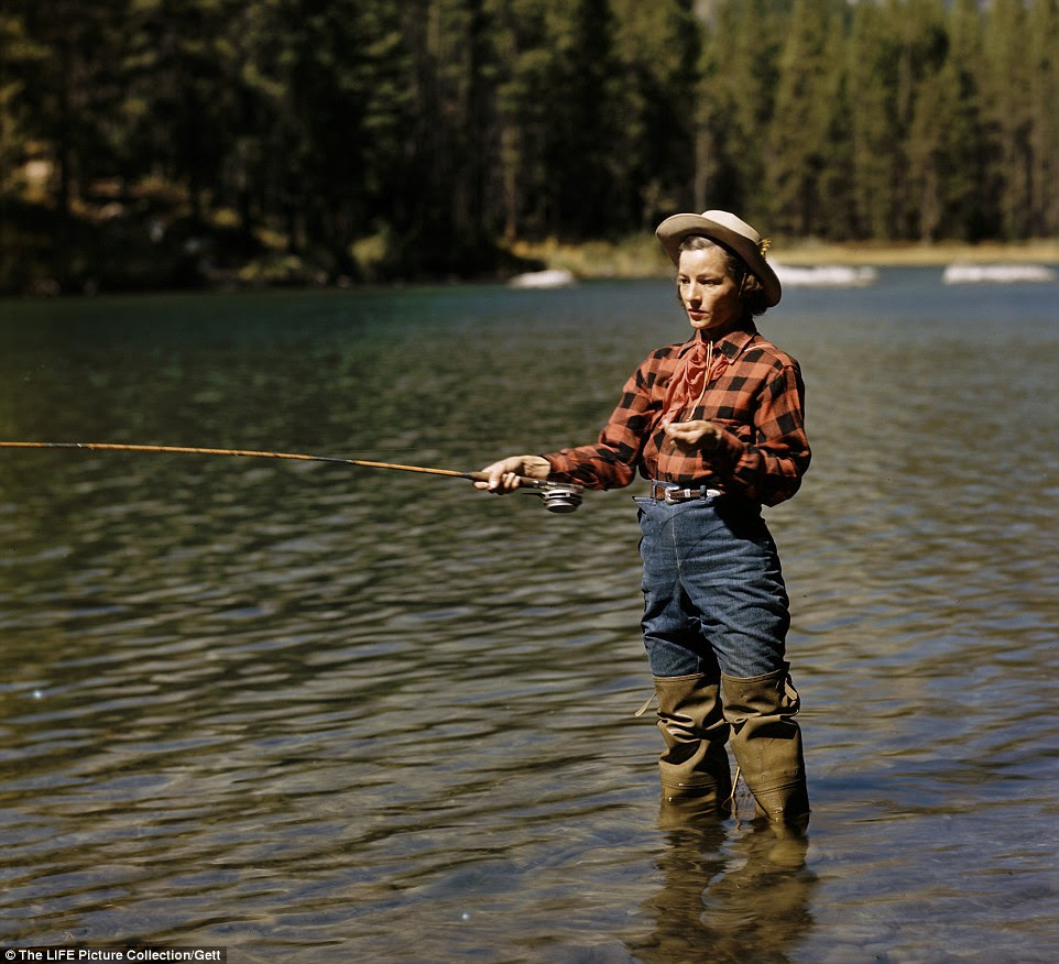 Simpler times: A young cowgirl trout fishing in String Lake in Jackson Hole wearing a  red checked, popular with many on cowboy ranches