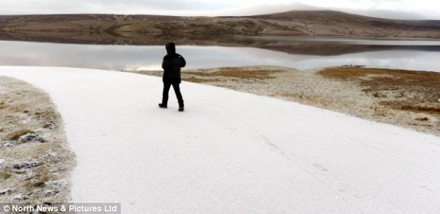 Beautiful scenes: He wanders along a stark white path in the bitterly cold North East