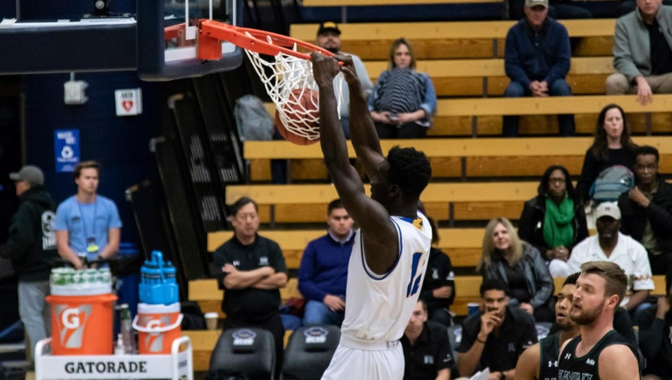 Amadou Sow dunks in the first half of UCSB's 79-61 win over Hawai'i on Thursday night. (Photo by Daniel Messinger)