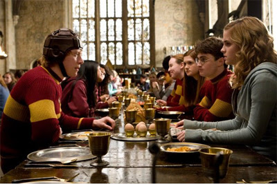 Ron, Ginny, Harry and Hermione at the Gryffindor's Table
