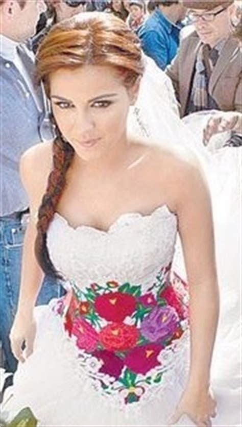 A Mexican traditional embroidered wedding dress, worn by