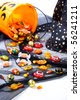 Scatter Halloween candies over Wizard hat - stock photo
