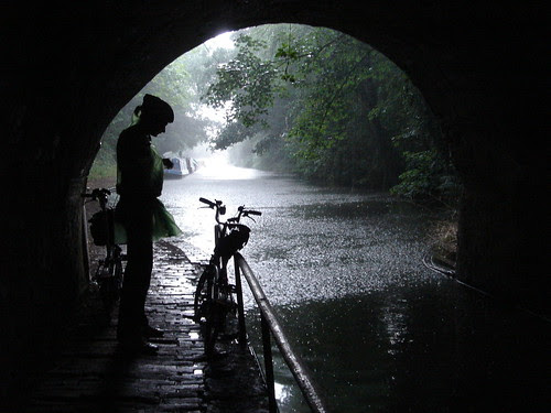 Waiting for the rain to pass - cycling with my daughter