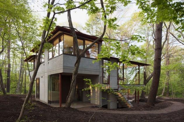 Diseño de casa de campo moderna construida en concreto