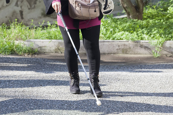 Blind woman with walking stick
