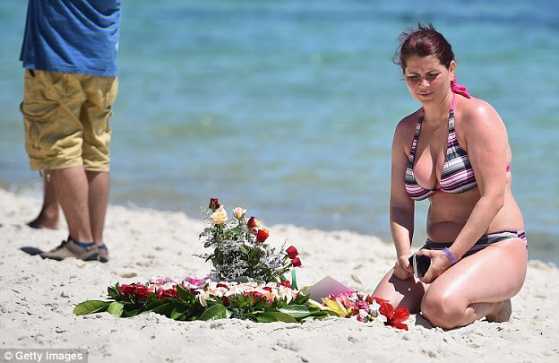Memorial: Holidaymakers who defiantly remained in Sousse after the murders were today laying flowers