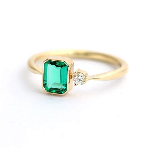 Emerald Engagement Ring with A Small Diamond   Asymmetric