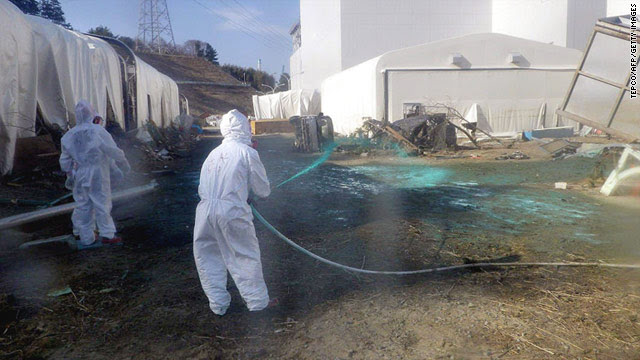 Workers try to stop the spread of radiation at the damaged Fukushima Daiichi nuclear plant.