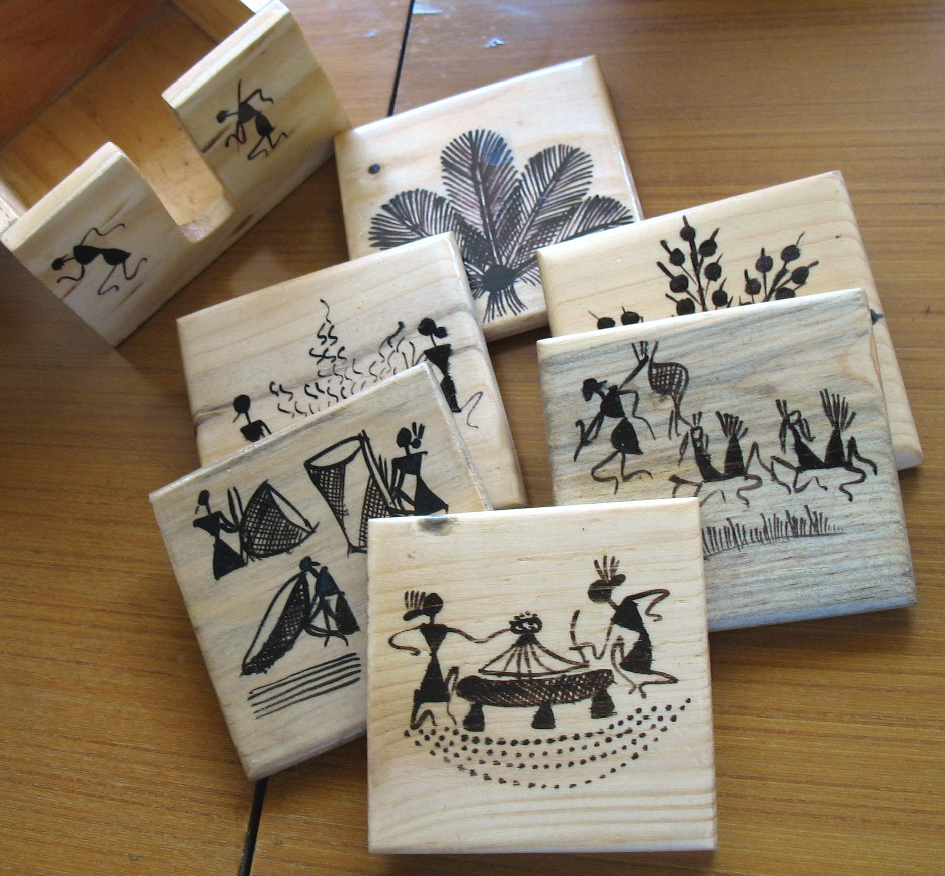 wooden coasters with warli drawings