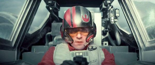 An X-Wing pilot played by Oscar Isaac is focused on the mission at hand in STAR WARS: THE FORCE AWAKENS.