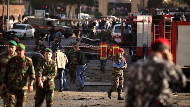 Lebanese troops inspect the scene of a car bomb explosion that rocked central Beirut, on December 27, 2013