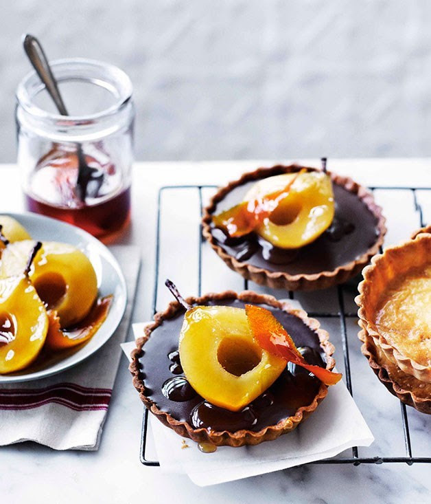 Chocolate ganache tartlets with muscat poached pears ...
