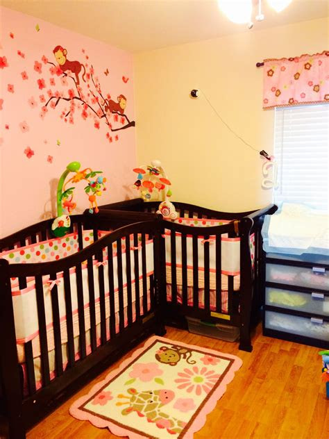 twin girl nursery   small room  shape monkey themed