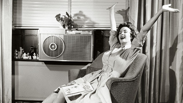 woman-with-air-conditioner.jpg (640×360)