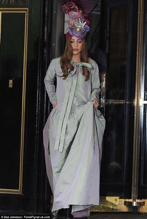 Lady Gaga steps back in time in a regal headpiece and