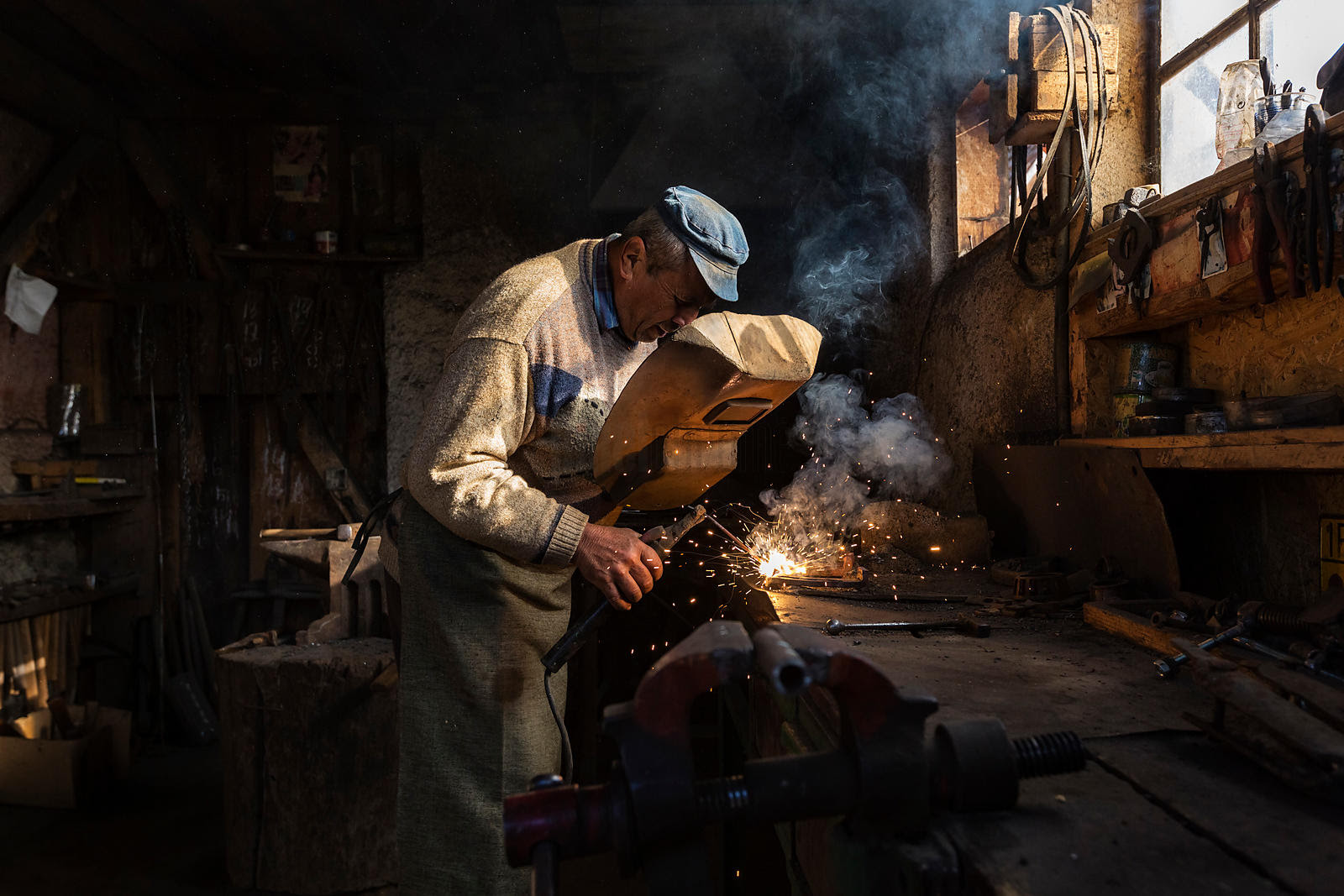 Where In The World Lifestyle Culture Landscapes Cityscapes Wildlife Travel Portrait Of A Blacksmith Using A Welder In His Forge Photo Tours