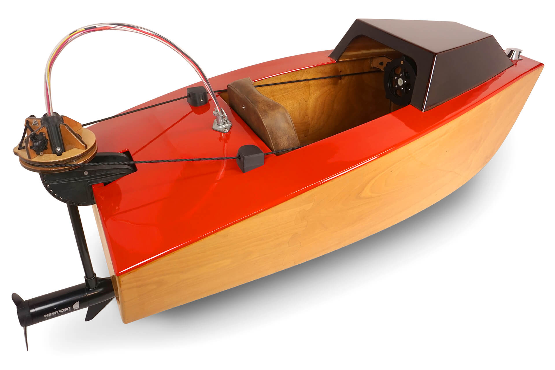 A rear 3/4 view of the mini electric boat, showing off the electric trolling motor propulsion