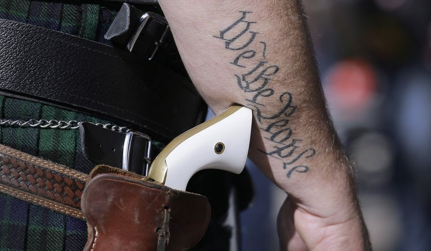 Scott Smith wears a pistol at a rally in support of open carry gun laws on Jan. 26, 2015, in Austin, Texas. (Associated Press)