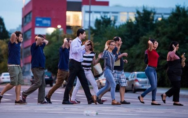 People are evacuated from the shopping mall following the shooting.