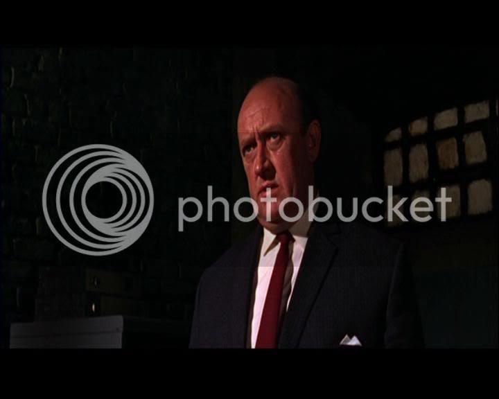 Ivor Dean as Inspector Micheaud