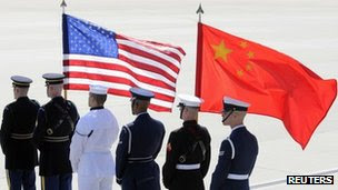 A colour guard of US. and Chinese flags awaits the plane of China's President Hu Jintao at Andrews Air Force Base, Maryland (file photo)