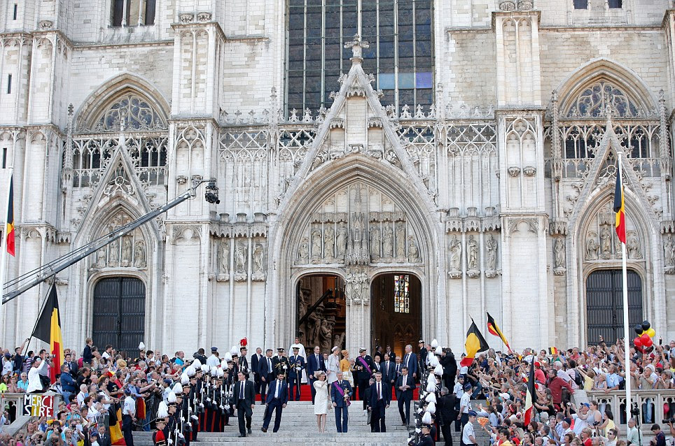 Grand: The new monarch King Philippe of Belgium and his wife Queen Mathilde posed on the steps of the impressive Cathedral of St Michael and Saint Gudula