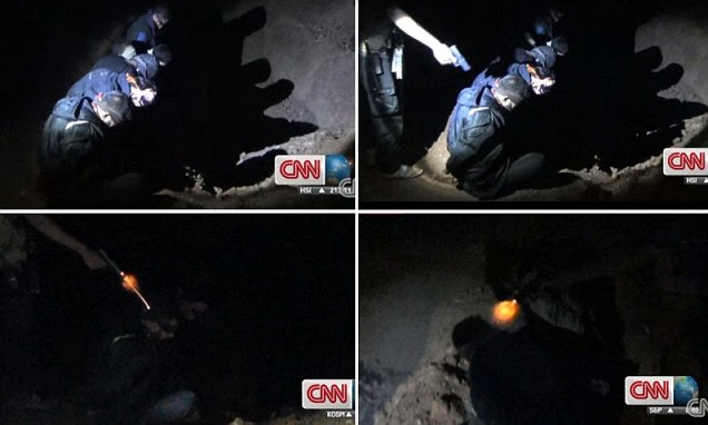 WARNING: GRAPHIC CONTENT. The video shows the blindfolded men - some of whom appear to be just teenagers - kneeling in front of a pit at night