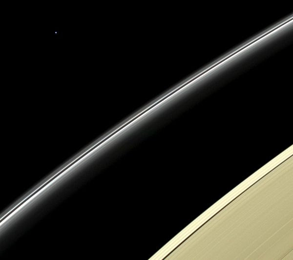 The pale blue dot of Uranus floats high above Saturn's rings in this image taken by NASA's Cassini spacecraft...on April 11, 2014.