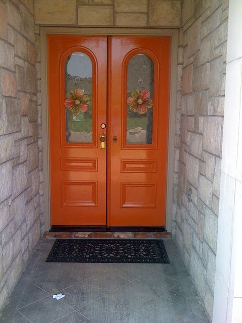 my mom's freshly painted front doors. Orange Blossom by Benjamin Moore rachelbnewman