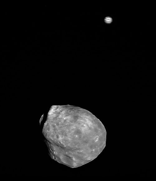 The Martian moon Phobos, with Jupiter in the background, photographed by the European Space Agency's (ESA) Mars Express orbiter on June 1, 2011.