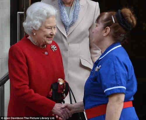 The Queen's nurse is wearing a belt buckle bearing Masonic symbols