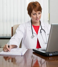 Photo: A healthcare professional at a computer