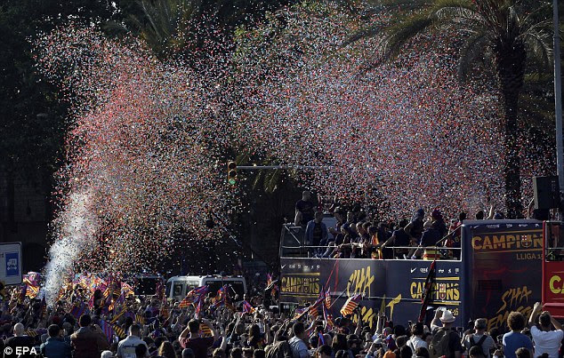 Confetti is released as Barcelona's supporters celebrate being crowned champions with their stars