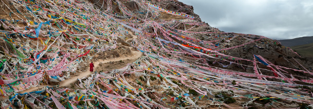 Phil Borges|Prayer flags surrounding the Kora (path) around the Princess Wencheng Temple. Qinghai Province
